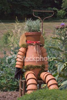 pot man for garden | Garden Decoration sitting clay pot man Royalty Free Stock Photo