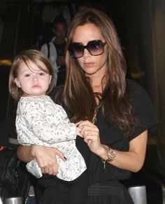 Victoria Beckham Carrying Baby Harper at JFK