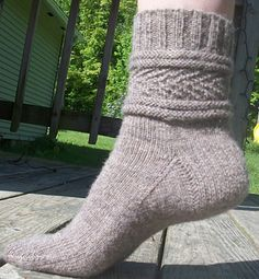 "This is a simple and beautiful sock knit from the top down, good for any level of sock knitting experience. Pattern calls for 2 circular needles. Techniques include knit, purl, ssk (slip,slip, knit), k2tog. The herringbone pattern really ""pops"" with lighter solid color yarns."