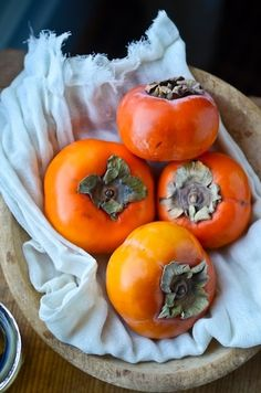 Persimmons or kaki on a light blue cloth. Fruit And Veg, Fruits And Vegetables, Fresh Fruit, Fruits Photos, Fruit Picture, Fruit Photography, Tropical Fruits, Delicious Fruit, Fruit Art