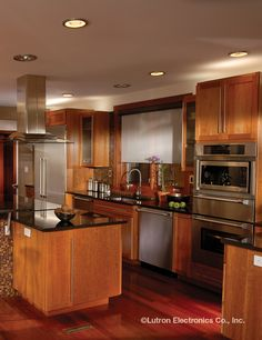 Kitchen recessed lighting layout and planning recessed lighting recessed lighting accents the medium brown wood and dark granite counter tops in this traditional mozeypictures Images