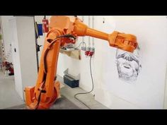 Two robots mimic an artists hand strokes in real time, resulting in three versions of the same drawing--one by the artist and two by the robots.