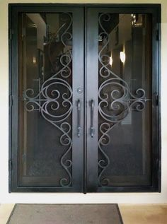 View our wrought large range of wrought iron products. From Wrought Iron Gates to Wrought Iron doors to Wrought Iron balustrades, we've got it all. Wrought Iron Security Doors, Wrought Iron Doors, Metal Doors, Porch Doors, Entry Doors, Entryway, Gate Design, Door Design, Iron Front Door