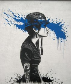 Street Painting by Fin Dac. Fantastic urban piece of art. The girl with tatoos reflects the state of today's society.
