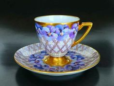 Violets in a cup.
