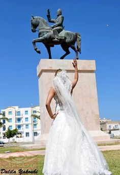 a bride honoring bourguiba's staut. African Union, North Africa, Statue Of Liberty, Bride, Country, World, Travel, Image, Sustainable Development