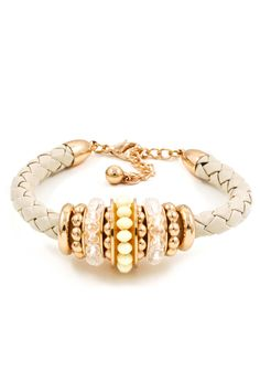 Concord Bracelet - Golden Rings weaved with Ivory and Clear Crystals layered onto Braided Leather.  This is the perfect mix of casual + classy and the neutral colors will go with just about anything.