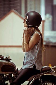 Motorcycle girl putting her helmet