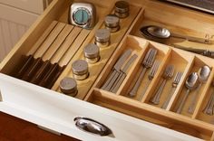 The kitchen workhorse drawer: Let it contain your everyday flatware, plus any other small tools you reach for constantly(measuring cups and spoons, an extra timer), and that's it.