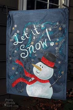 let_it_snow_flag_sunlit Garden Flag made from dollar store placemats. prettyhandygirl.com
