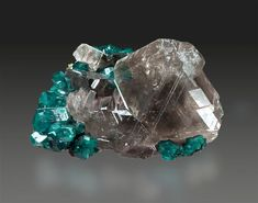 Cerussite on Dioptase: a grounding stone; attunes the holder to higher wisdom and greater life purpose; can reveal truths through meditation | #perspicacityparty #magicgeodes #cerussite