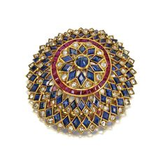SAPPHIRE, DIAMOND AND RUBY BROOCH, VAN CLEEF & ARPELS, NEW YORK, 1948. Set with rose-cut diamonds weighing approximately 3.35 carats, lozenge-shaped sapphires, a cabochon sapphire, and calibré-cut rubies, mounted in gold, signed Van Cleef & Arpels, NY, numbered 14197.