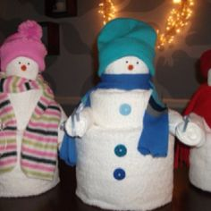 Towel snowmen. Roll baths towels, hand towels and wash clothes, like you would for a towel wedding cake. I picked up the hats and scarves at dollar stores.