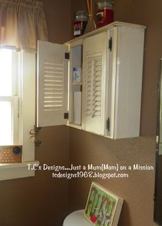 Repurpose a drawer & shutter combo as a bathroom cabinet.