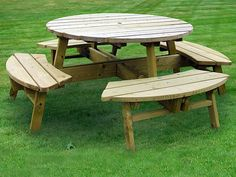Wooden picnic table, round outdoor table, perfect for picnics or evening meals, could be used for personal use or in a public park. Built from high quailty treated wood, will last and will withstand all types of weather. Will look great in any size garden or park.   For more information, and information on high Quality lawn edging, bamboo root barrier and more products contact Best4Garden.co.uk