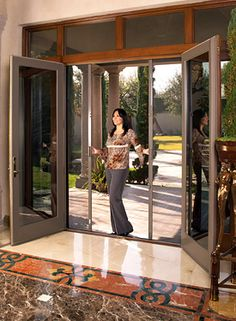 Install french doors w/ sliding screen doors - I think this would make the doorway to the back yard make everything feel so much more open and relaxing. I want these off our dining room/kitchen to the back deck House Design, House, French Doors, Home, Security Screen Door, Sliding Screen Doors, House Exterior, New Homes, French Doors With Screens