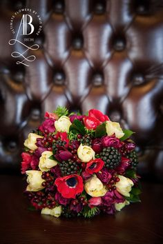A winter wonderland bridal bouquet of opulent colours in reds, burgundy's and the blackberry.