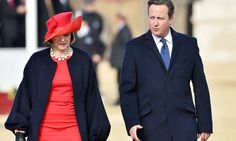 """The"" (Brit's, not mine) Queen's hat maker must have inspired red hat & dress power outfit. Theresa May with David Cameron"