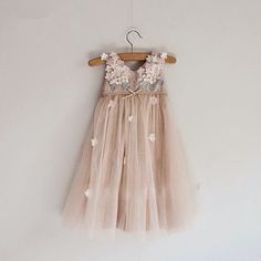 The most beautiful tulle in dusty rose color is embellished with satin flowers appliques. Accessorize it with our matching flower headband for a