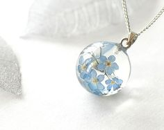 Real Forget-me-not Flowers Necklace - blue Forget me not in Globe ball Resin - Myosotis sylvatica. via Etsy.