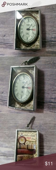 """Jewell Kade Charm Jewell Kade Charm """"Take a little ME Time"""" Charm. One side shows a clock. The other side shows some books, a clock and the words """"Take a little ME Time"""" Jewell Kade Jewelry"""
