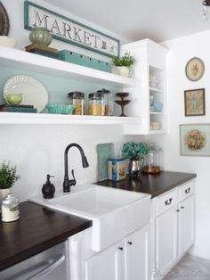 Butcher block counter, white cabinets & farm sink.  Yes, please!