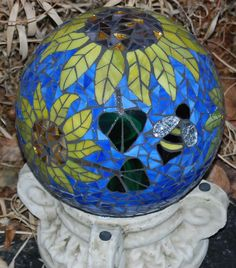 My next bowling ball?  Gazing Ball Lady Bug and Bee in the Sunflowers by Schilltill, $80.00