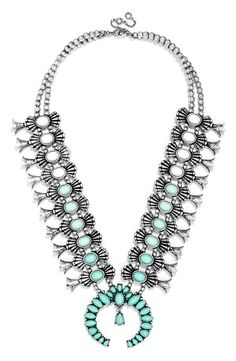 Standing out with this turquoise and silver amulet necklace from BaubleBar!