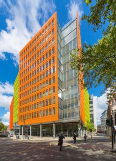 The Central St. Giles Court in London features a façade made with steel, glass, and vibrant tiles of glazed terra-cotta cast with a crosshatch pattern.