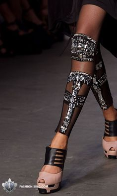 Really? Let's chop up the leg and put just tons of bling all over the leg, anything to distract attention away from one's face. Just where to wear these?
