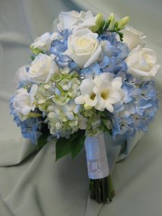 blue hydrangea wedding centerpieces | Blue hydrangea, white roses and fressia with crystals.