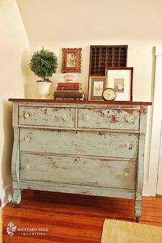 Lovely distressed green dresser.  And the vignette is nice too.