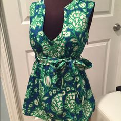 J. Crew top Lovely J. Crew top. Side zipper. Belted. Great condition. J. Crew Tops