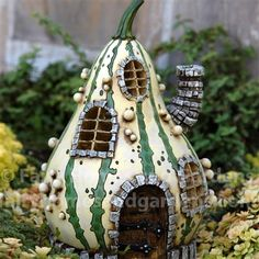 Fiddlehead Striped Gourd Fairy House at http://www.fairyhomesandgardens.com