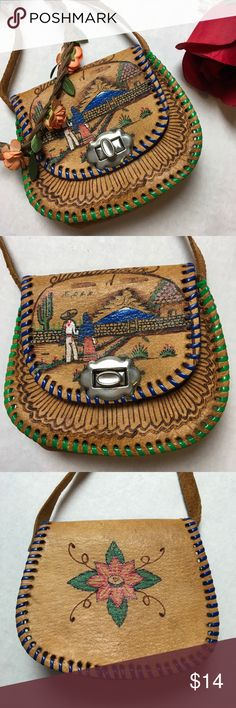 Gorgeous Hand Painted 🐫 Vintage Coin Bag 🌵 This is beautiful! It's very old. Bought in Mexico. Made of camel skin. Hand painted. Long strap but used for coins or keys. Just a few inches across each side. It does have wear and stains. Some rust on the side studs and opening. I'm not sure how to clean it. It's been hanging in my jewelry box forever and I thought someone would love to have this beauty! Please ask any questions. 😘 Vintage Bags Mini Bags