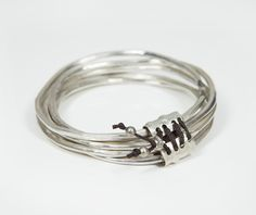 Silver bangles by 962