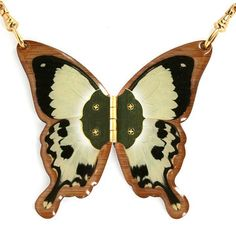 Real butterfly on a bamboo frame necklace! They have different color and styles. You can also wear it closed like a locket!