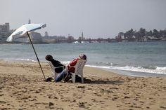 A couple sitting on Beach Alexandria