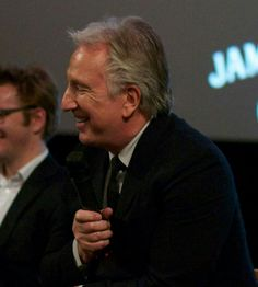 """March 28, 2015 - Alan Rickman at the Dublin International Film Festival, which was sponsored - in part - by Jameson Whiskey, which accounts for the """"JAM"""" on the screen behind Alan."""