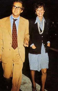 Dr. Andrea Dotti with his wife Audrey photographed walking at Rome's downtown after a dinner, in September 1974. -Audrey was wearing a silk dress of Valentino (of his collection for the Spring/Summer of 1973), cardigan of Sonia Rykiel and Charles Jourdan shoes.