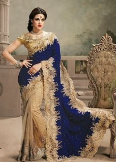 http://fashionemporia.in/GOLDEN-WITH-BLUE-HEAVY-EMBROIDERED-PARTYWEAR-DESIGNER-SAREE-WITH-BLOUSE-id-823971.html