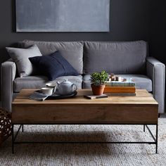 Rustic Storage Coffee Table | west elm - two sizes to choose from, has storage inside