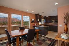 Sedona vista Suite  This luxury furnished vacation rental condo is a mixture of warm and cool tones, with large contemporary art. The furnishings are stylishly modern. The panoramic views of Sedona are breathtaking from the living areas and the private deck. The master king suite is in satins of brown and blues and offers an ensuite bath with glass enclosed shower. The second bedroom has one queen bed and one twin bed and is fitted in earthly beige, brown and sage. 2Bedroom/2Bath