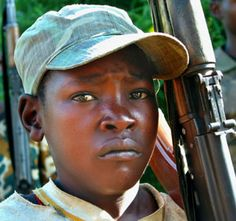 Child soldiers from Uganda. This photography expresses the sadness  and suffering that these children are going  through, because of being subjected to kill at an early age.