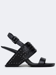 - Be a style icon in these one-of-a-kind, unique sandals from United Nude! - Studded heels have an edgy look complete with a slingback design and an adjustable buckle closure - Non-skid sole and cushi