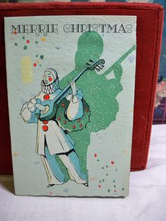 1930's  art deco  Christmas card  pierrot playing a by puffadonna,