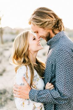 Zach and Jordan's sun drenched desert engagement session was nothing short of amazing. They decided to meet in Joshua Tree to document this special occasion. Click through to see more and read their cute engagement story!CreditsPhotographers: Jenna Bechtholt PhotographyMakeup Artist: Elizabeth RootFashion: Free People Dress