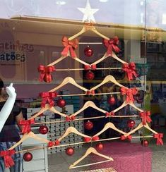 30 Adorable Christmas Window Decor That Shows Your Creative Side - HomelySmart Christmas Shop Displays, Hanger Christmas Tree, Christmas Window Decorations, Christmas Store, Noel Christmas, Christmas Shopping, Christmas Crafts, Holiday Decor, Christmas Markets