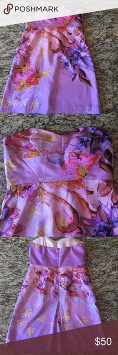 Ali Ro Strapless Floral Dress Ali Ro (Saks 5th Ave) Dress, NWOT, Size 8. Gorgeous pinks and purples in abstract Floral pattern. Lined with boning and support strap. Small imperfection on bottom, not sure what it is since it's never been worn. Smoke Free Home. Ali Ro Dresses