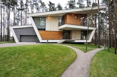 Atrium Architects designed this house for a young family, located on the top of a hill surrounded by pine trees near Moscow, Russia.